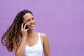 Smiling woman talking on cell phone and looking away Royalty Free Stock Photo