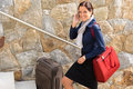Smiling woman talking phone business traveling rushing Royalty Free Stock Images