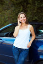 Smiling woman talking on phone in a cabriolet car caucasian Royalty Free Stock Image
