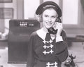 Smiling woman on the telephone Royalty Free Stock Photo