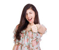 Smiling woman with thumbs up gesture Royalty Free Stock Image