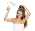 Smiling woman in towel blow dry isolated on white Royalty Free Stock Photo