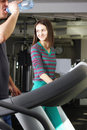 Smiling woman on treadmill Royalty Free Stock Photos