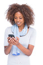 Smiling woman typing a text message on her smartphone white background Royalty Free Stock Image