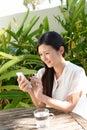 Woman looking at smart phone Royalty Free Stock Photo