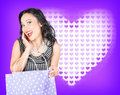 Smiling woman with a valentines day gift bag beautiful on hearts background Stock Photos
