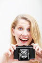 Smiling woman with vintage photo camera Stock Photography