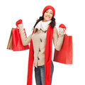 Smiling woman in warm clothers with shopping bags retail and sale concept full length picture of happy winter clothes Royalty Free Stock Photography