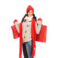 Smiling woman in warm clothers with shopping bags retail and sale concept full length picture of happy winter clothes Stock Photo