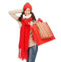 Smiling woman in warm clothers with shopping bags retail and sale concept happy winter clothes Stock Photography