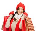 Smiling woman in warm clothers with shopping bags retail and sale concept happy winter clothes Royalty Free Stock Image