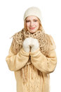 Smiling woman in warm clothing young winter standing isolated on white background Stock Photo