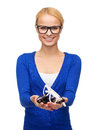 Smiling woman wearing and holding eyeglasses vision health concept in casual clothes Royalty Free Stock Image