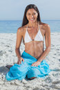 Smiling woman wearing sarong on beach Royalty Free Stock Photo