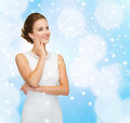 Smiling woman in white dress with diamond ring Royalty Free Stock Photo