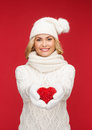 Smiling woman in winter clothes with red heart christmas x mas charity love happiness concept Stock Photo