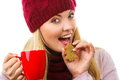 Smiling woman in woolen cap and shawl with gingerbread cookies and tea white background christmas time decorated or red cup of hot Royalty Free Stock Image