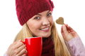 Smiling woman in woolen cap and shawl with gingerbread cookies and tea white background christmas time heart shape decorated or Royalty Free Stock Image