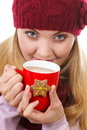 Smiling woman in woolen cap and shawl with gingerbread cookies and tea white background christmas time star shape decorated or red Stock Image