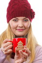 Smiling woman in woolen cap and shawl with gingerbread cookies and tea white background christmas time tree shape decorated or red Stock Photos