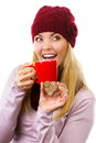 Smiling woman in woolen cap and shawl with gingerbread cookies and tea white background christmas time wearing holding decorated Stock Photography