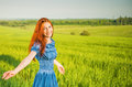 Smiling woman young happy on summer green fields Stock Image