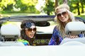 Smiling women in a cabrio Royalty Free Stock Photos