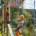 Smiling women having fun adventure park rope ladder Stock Images