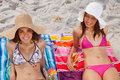 Smiling women looking at the camera while sunbathing Royalty Free Stock Image