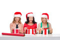 Smiling women in santa helper hats with gift boxes christmas x mas winter happiness concept three Stock Image