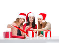 Smiling women in santa helper hats with gift boxes christmas x mas winter happiness concept three Royalty Free Stock Image