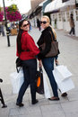 Smiling women shopping with white bags Stock Photos