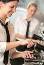 Smiling women waitress preparing coffee machine Royalty Free Stock Photo