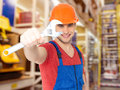 Smiling worker with big spanner portrait of Stock Image