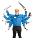 Smiling worker with tools in many hands Royalty Free Stock Photo