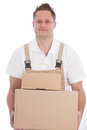 Smiling workman carrying boxes or delivery man in dungarees two brown cardboard Royalty Free Stock Photos