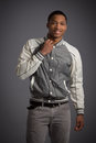 Smiling young african american male model natural looking casual dressed on grey background Stock Photos