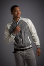 Smiling young african american male model natural looking casual dressed on grey background Stock Images