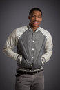 Smiling young african american male model natural looking casual dressed on grey background Royalty Free Stock Photos
