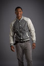 Smiling young african american male model natural looking casual dressed on grey background Royalty Free Stock Images