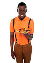 Smiling young african boy offering pizza Royalty Free Stock Image