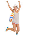 Smiling young beach woman hat jumping isolated white Stock Photos