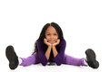 Smiling young black girl leaning on elbows Stock Photos