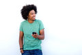 Smiling young black man holding cellphone Royalty Free Stock Photo