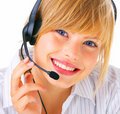 A smiling young blond wearing headset Royalty Free Stock Photo