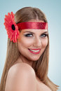Smiling young blond woman with flower decoration in hair Royalty Free Stock Image