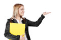 Smiling young blonde business woman holding yellow file while sh Stock Photo