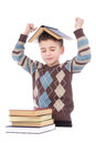Smiling young boy with a book on his head over white background Stock Images