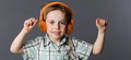 Smiling young boy dancing, listening to music on headphones Royalty Free Stock Photo