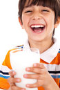 Smiling young boy holding a glass of milk Royalty Free Stock Images